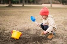 Girl diggin in yard