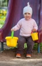 Girl with sand buckets