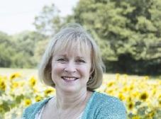 Cheryle Boyle in Field of Sunflowers